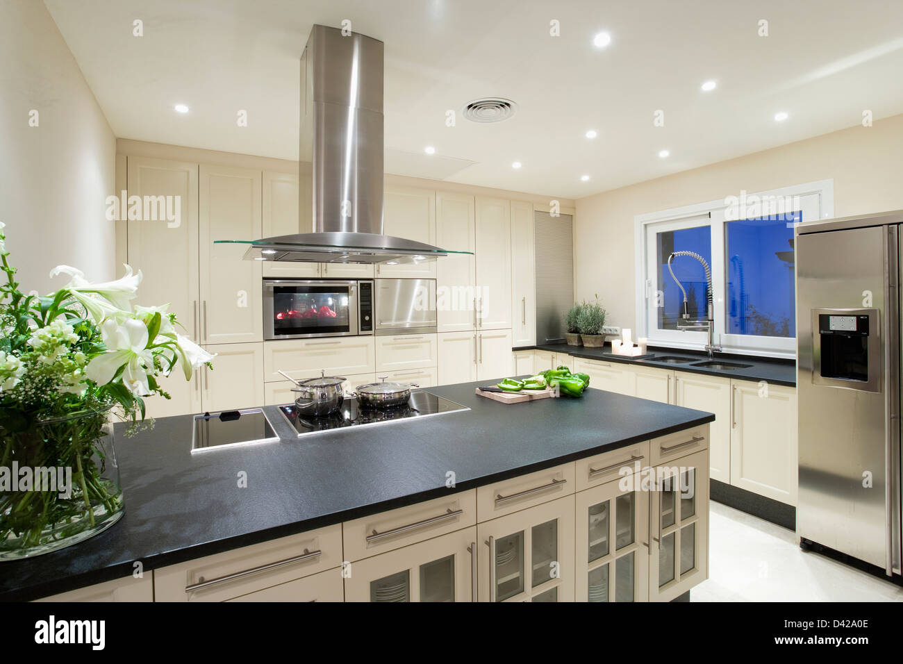 Chrome Extractor Above Hob In Island Unit With Black Granite Worktop Stock Photo Royalty Free