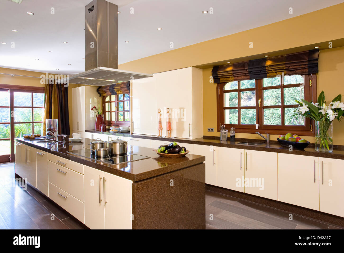 Extractor fan over island unit in modern kitchen in spanish villa stock photo royalty free - Kitchen island extractor fans ...