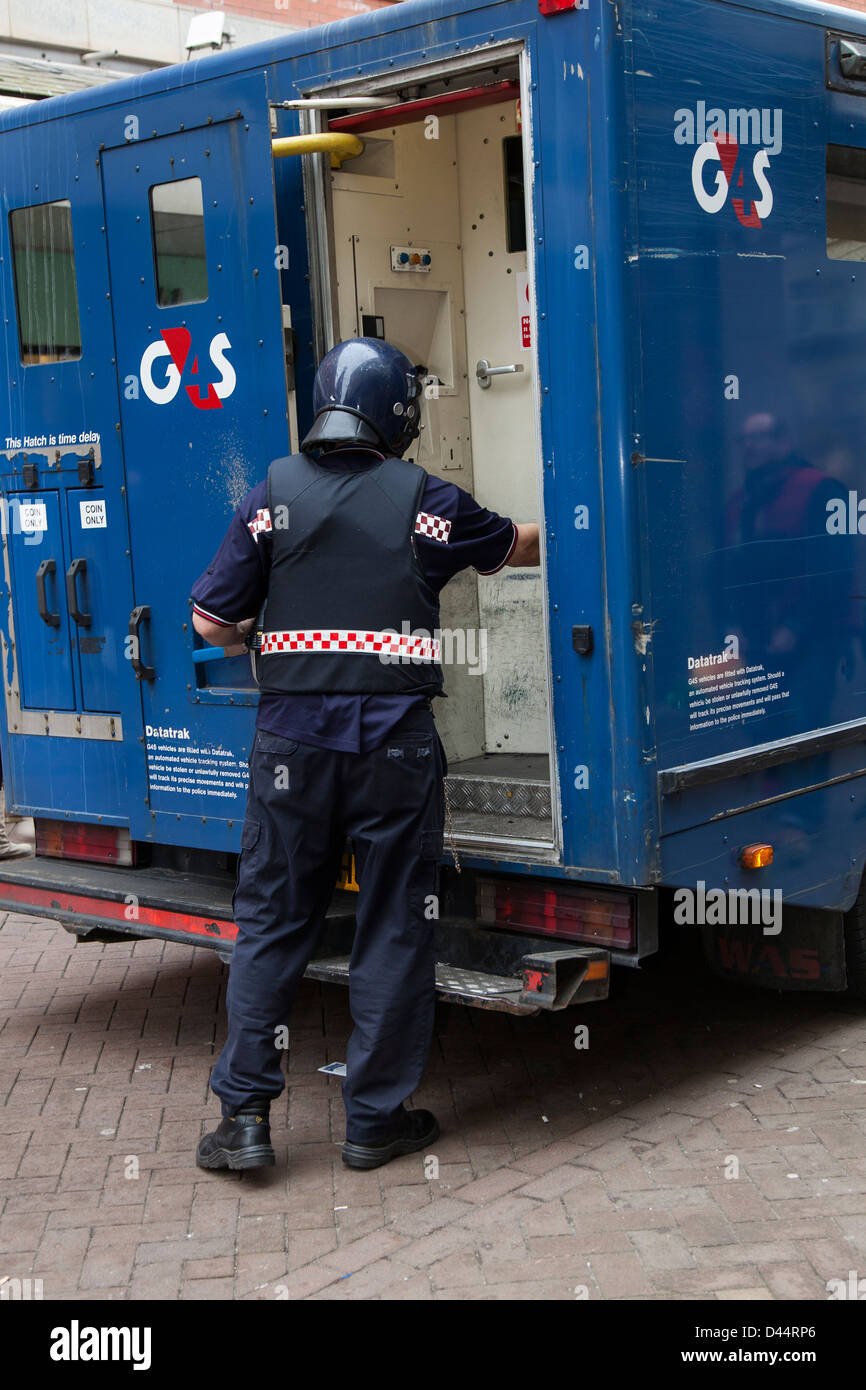 g4s loading security van through rear door of armoured vehicle in stock photo royalty free. Black Bedroom Furniture Sets. Home Design Ideas