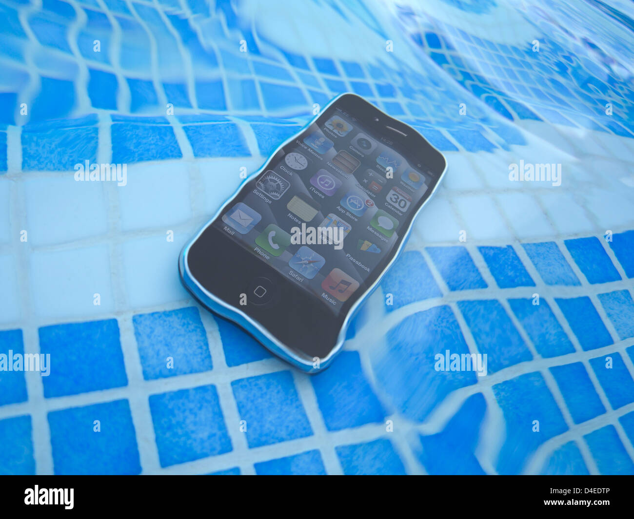 mobile cell phone dropped in swimming pool Stock Photo ...