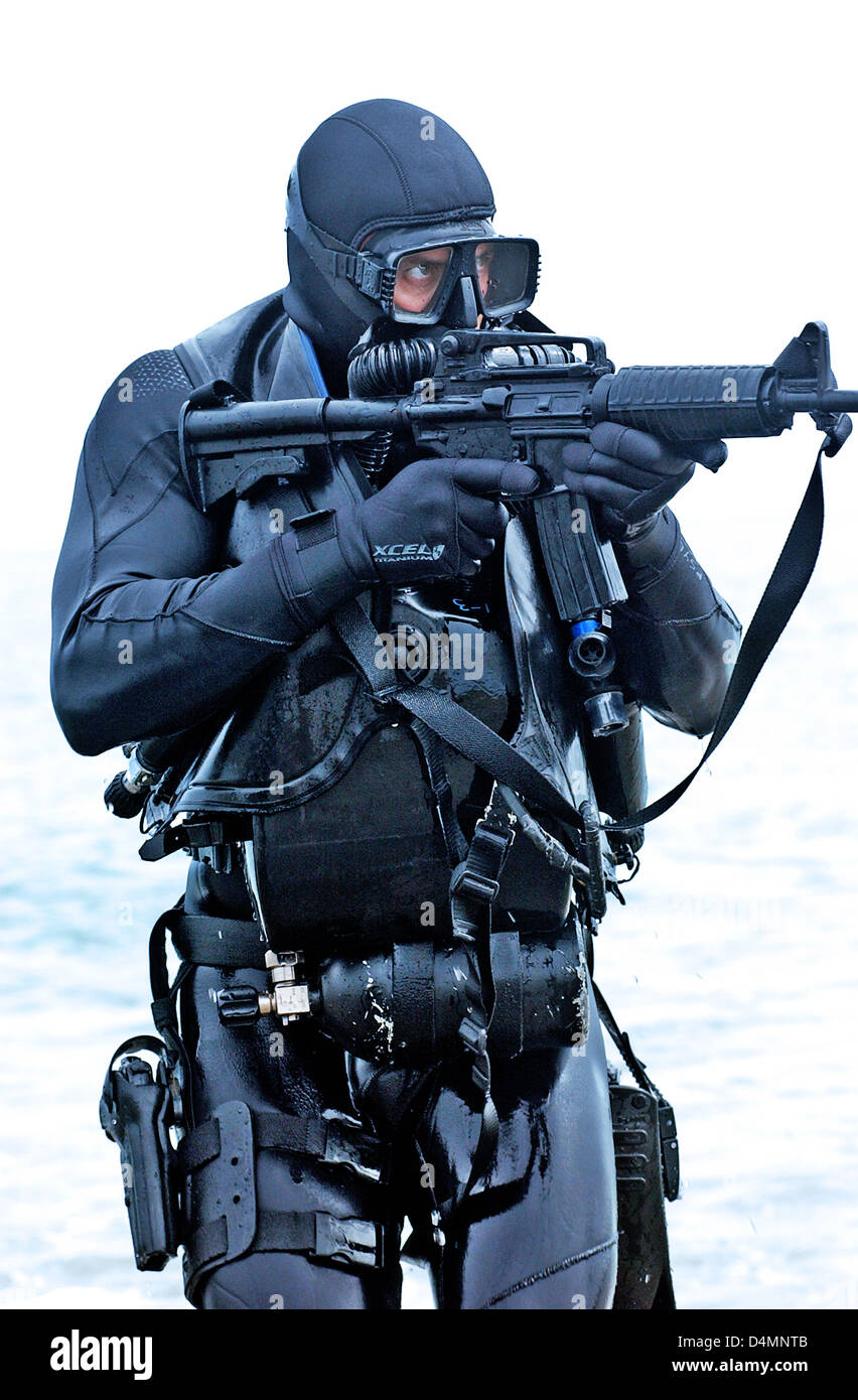 A member of a seal team practices water insertion techniques in scuba stock photo royalty free - Navy seal dive gear ...