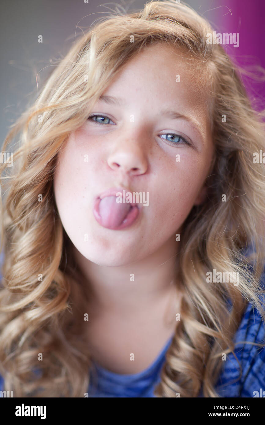 Girl Sticking Her Tongue Out Stock Photo, Royalty Free