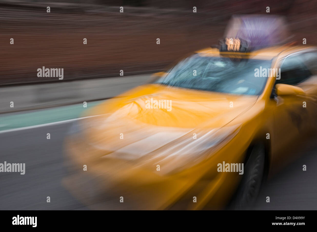 yellow-taxicab-blurred-to-show-movement-