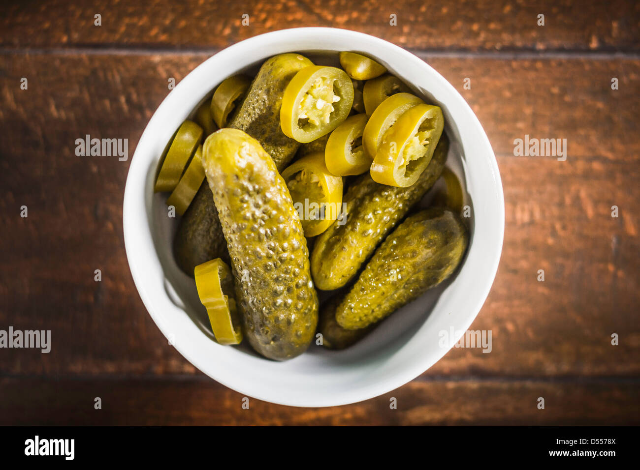 Bowl of pickles and chili pepper slices Stock Foto