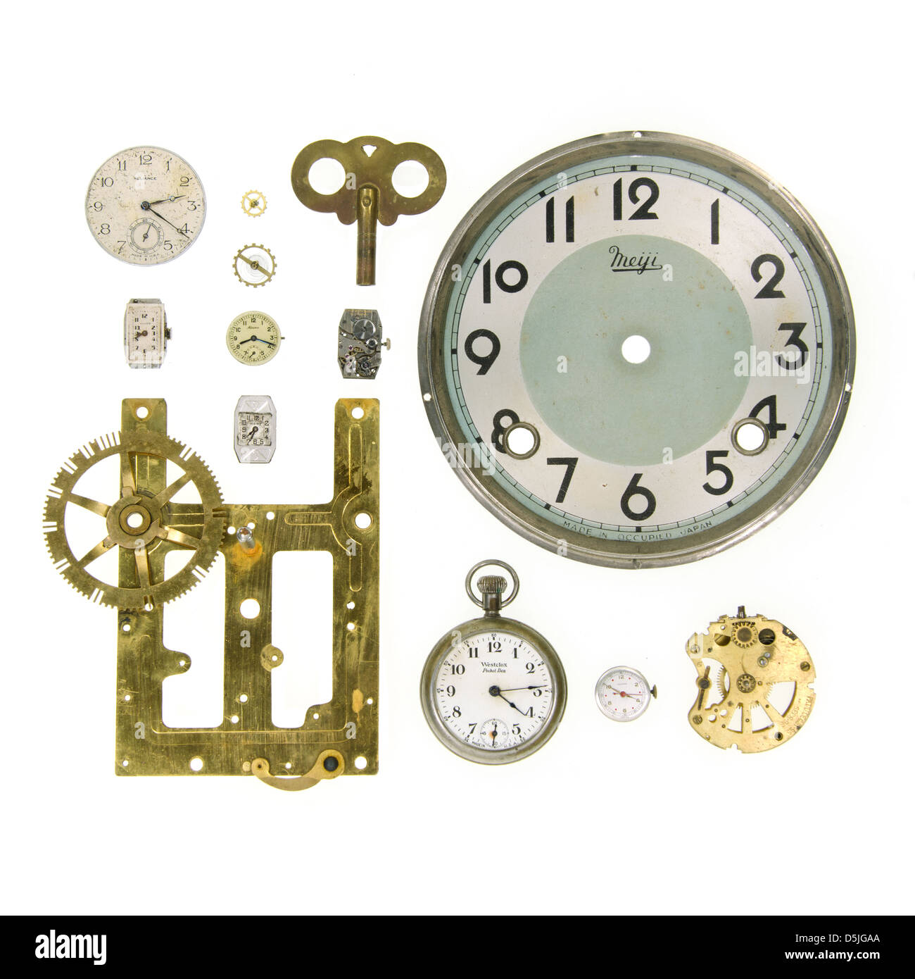 Clock parts, clock faces, and watch mechanisms on a white background Stock Photo