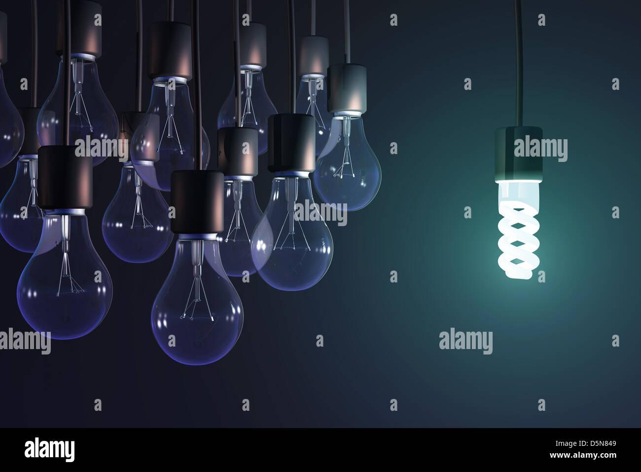 energy-saving lamp among the gray bulb Stock Foto