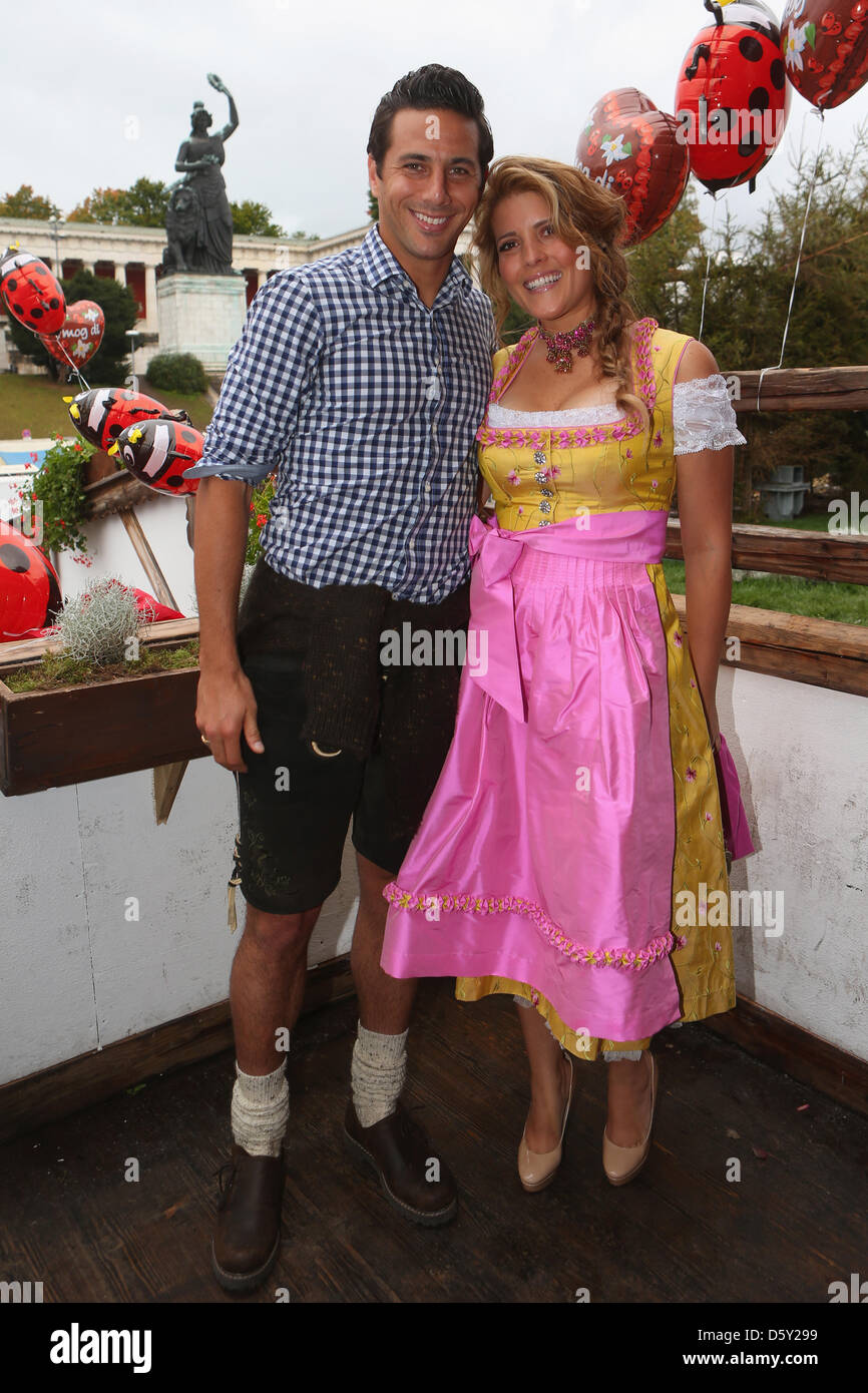 claudio pizarro of fc bayern muenchen attends with wife