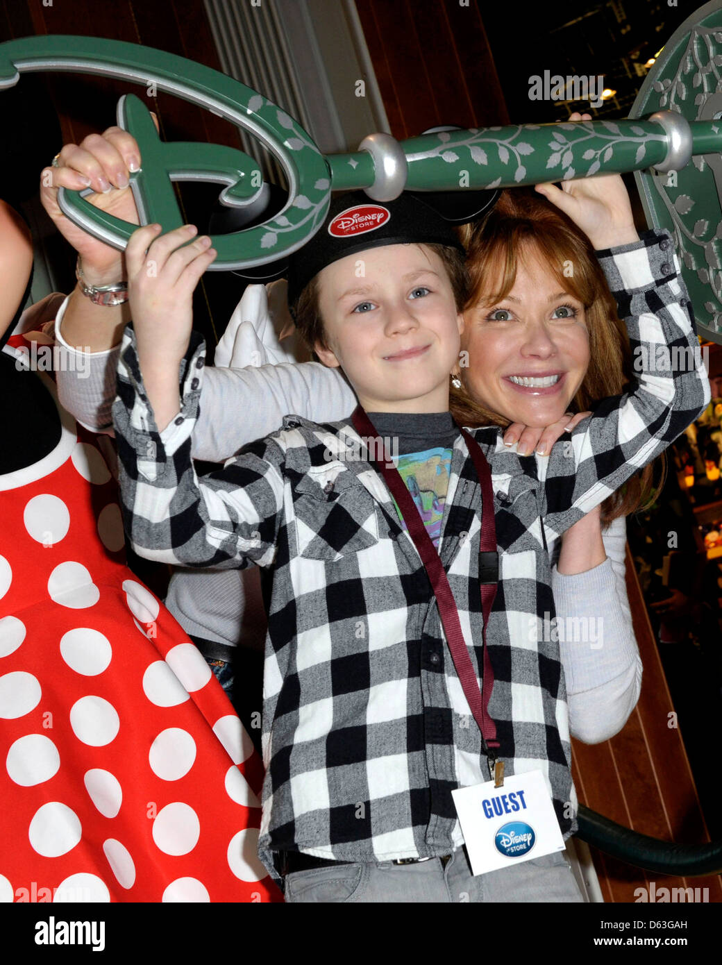 Lauren Holly and son Azer Greco attend the Disney Store re ... Lauren Holly George Greco