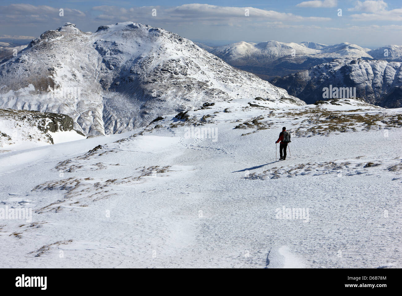 hillwalker-descending-the-snow-covered-s