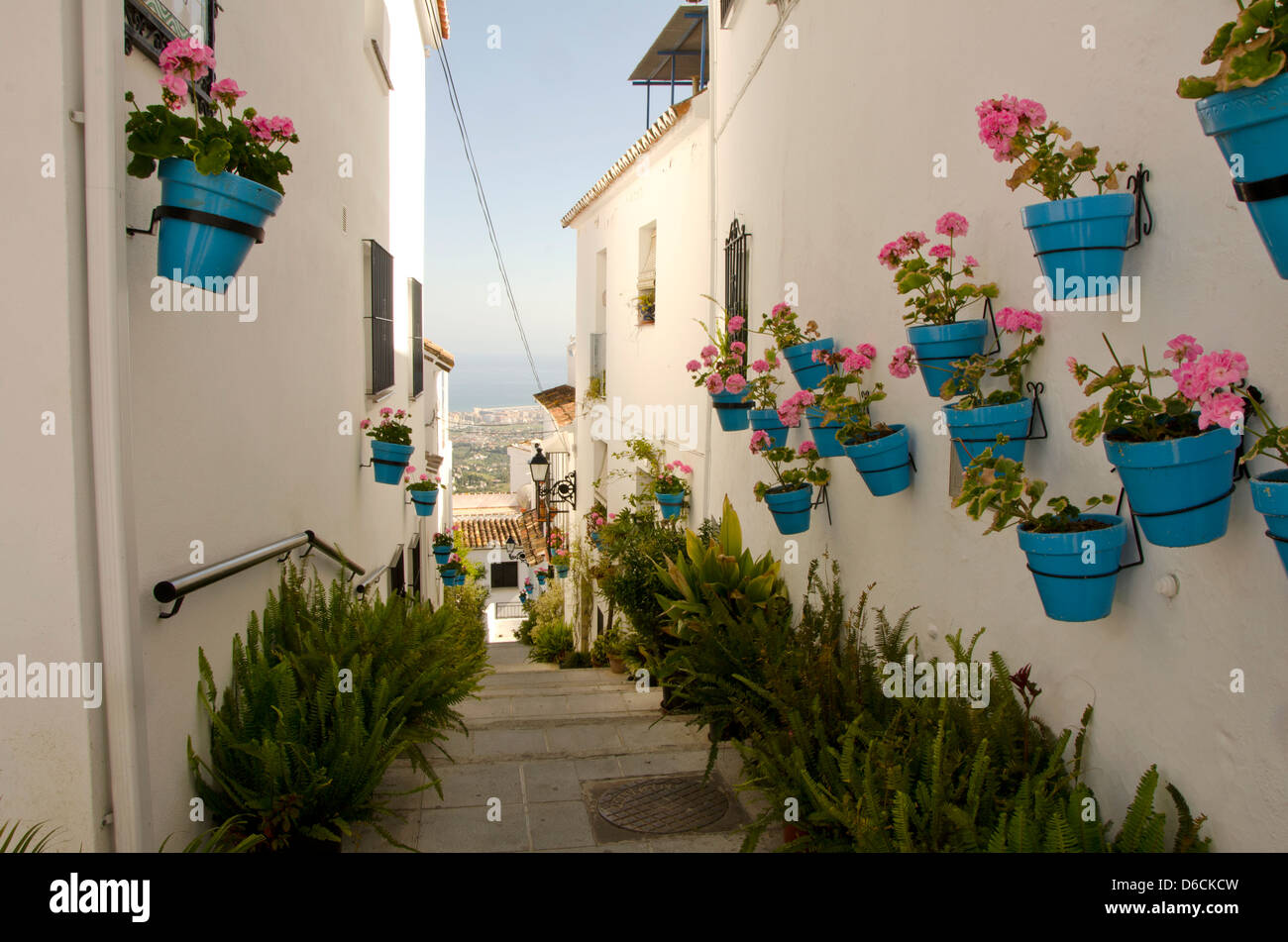Hanging Flower Pots On The Wall In The White Village Of