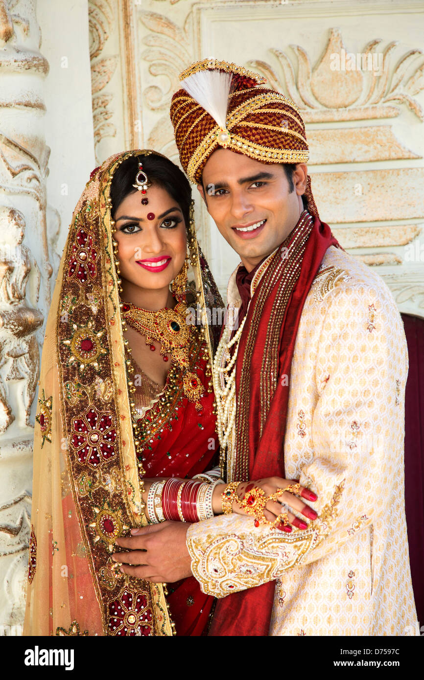 Indian Bride And Groom In Traditional Wedding Dress Stock Photo Royalty Free Image 56050720