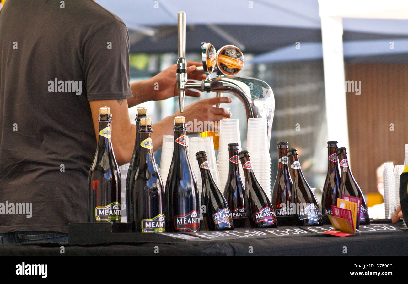 a-barman-pouring-real-ale-from-beer-taps