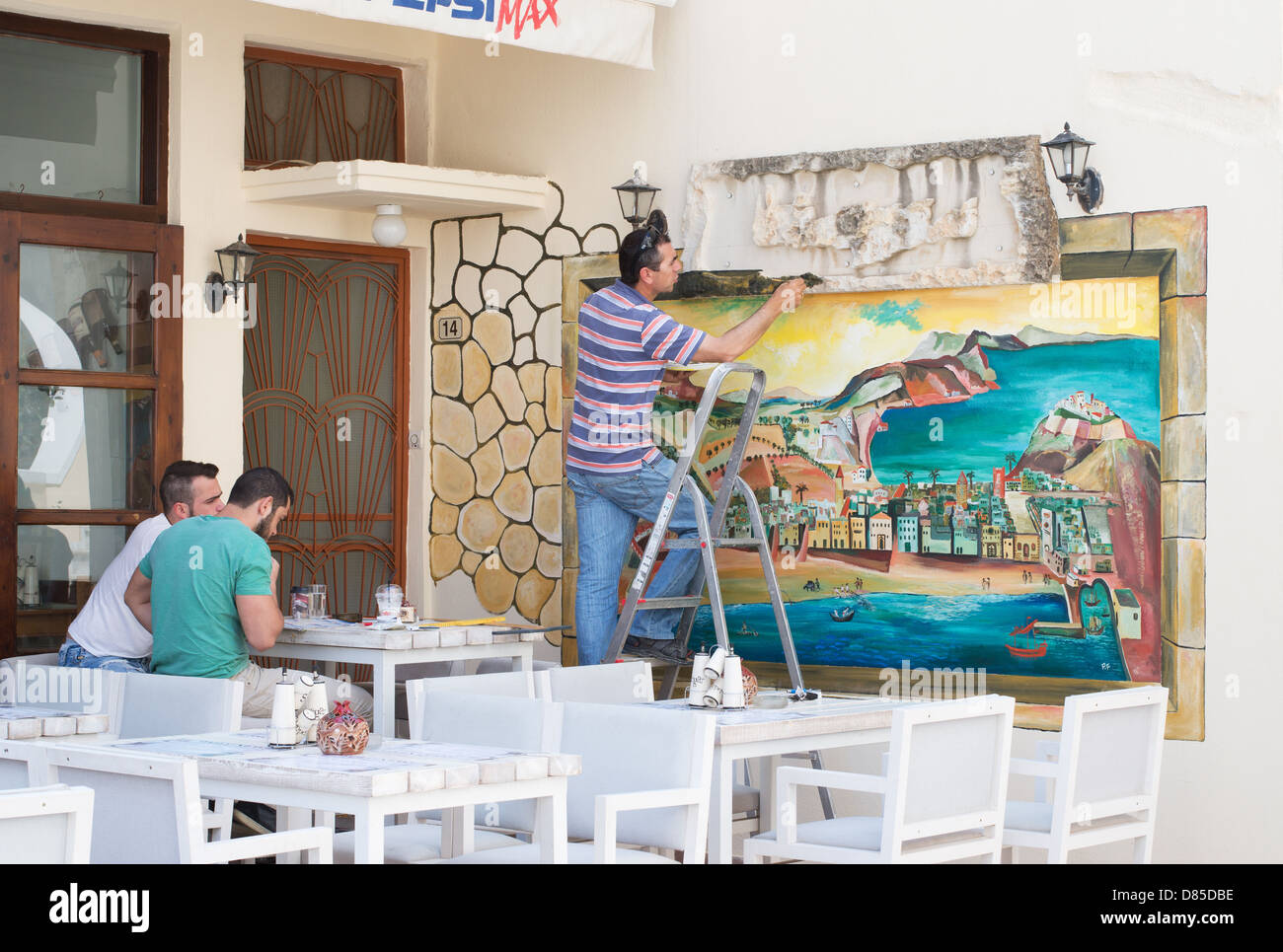 artist-painting-mural-at-a-caf-within-re
