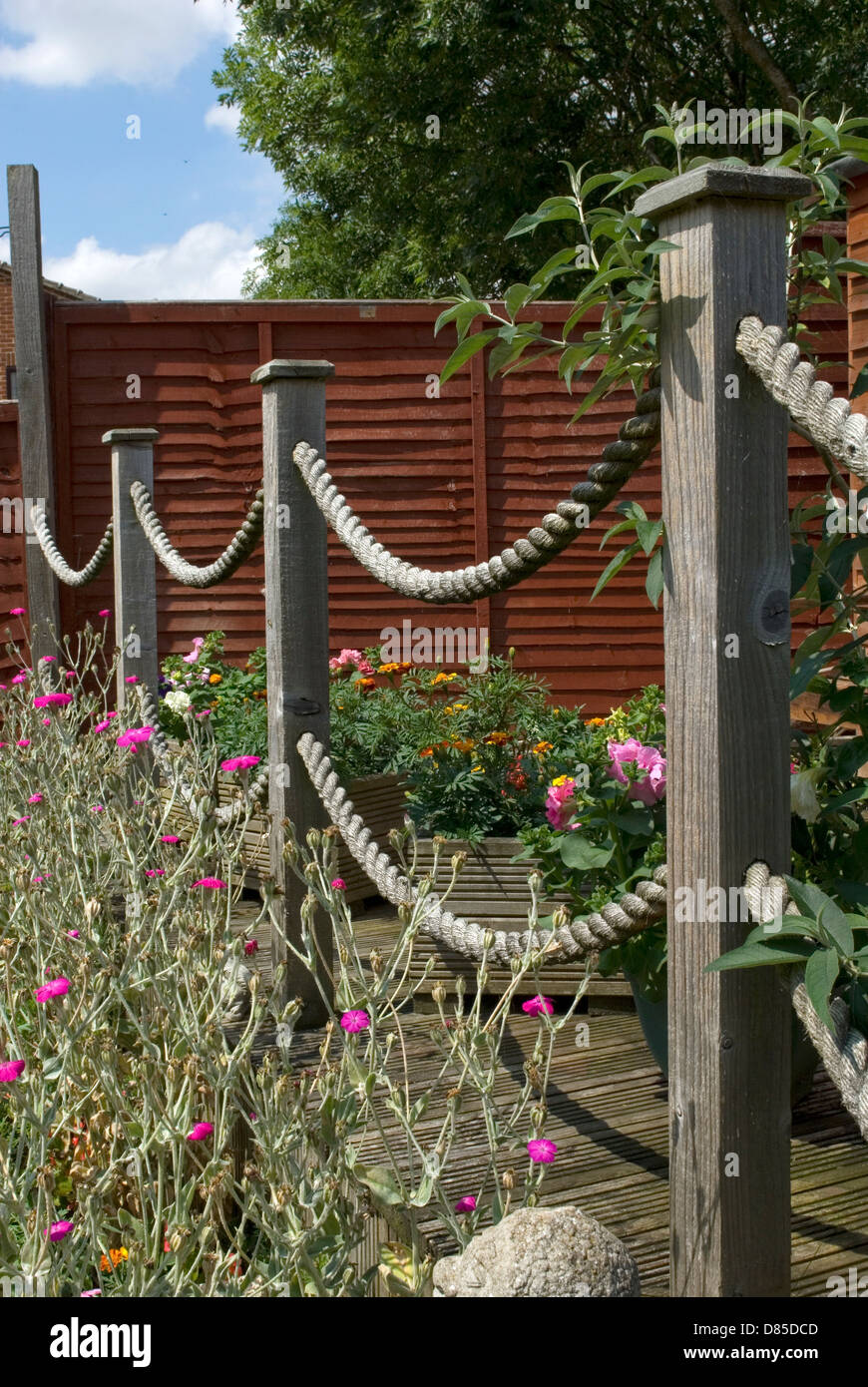 Garden decking posts in spring with rope loops stock photo for Garden decking with rope