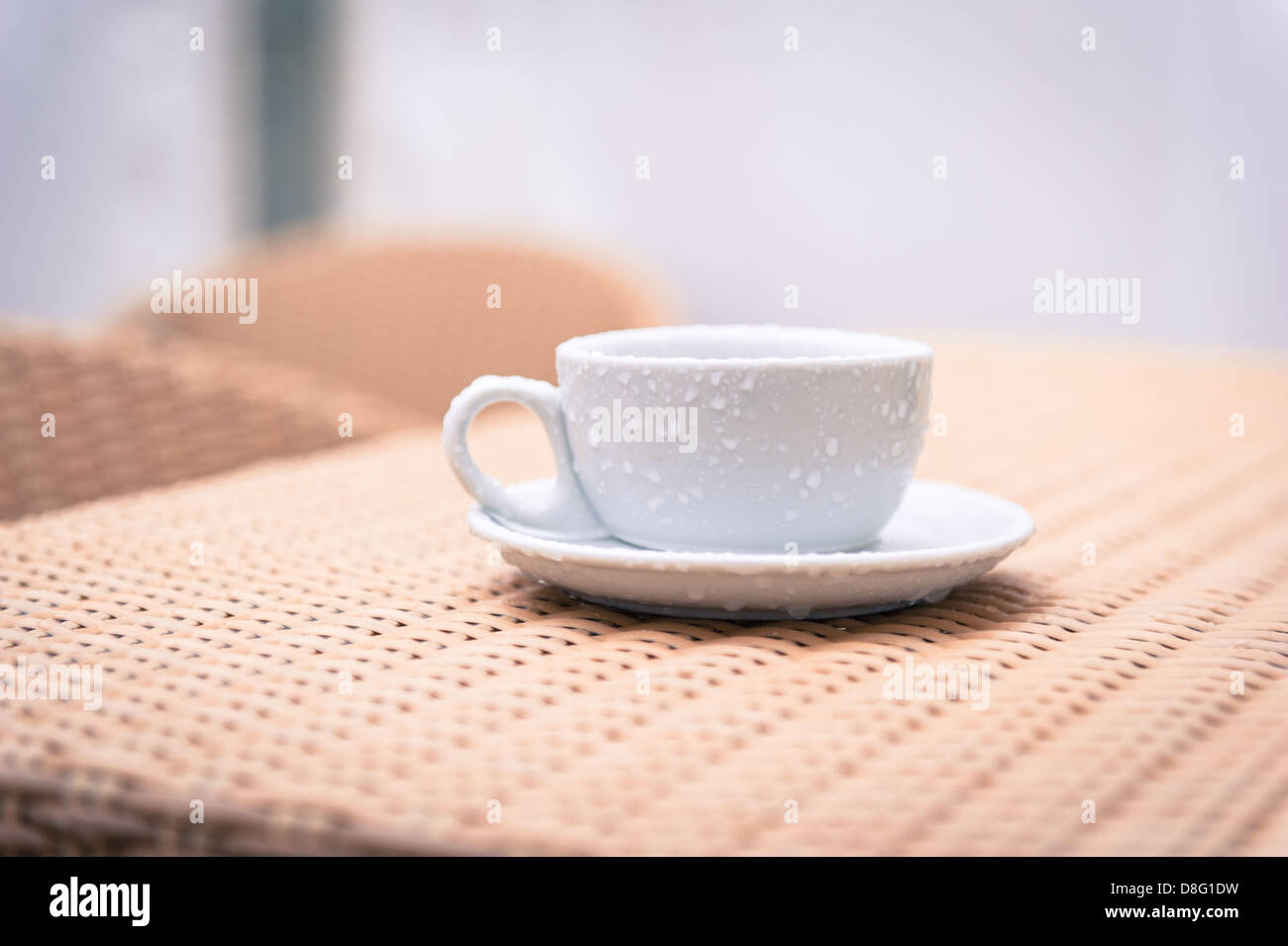 a-cup-and-saucer-left-out-in-the-rain-at