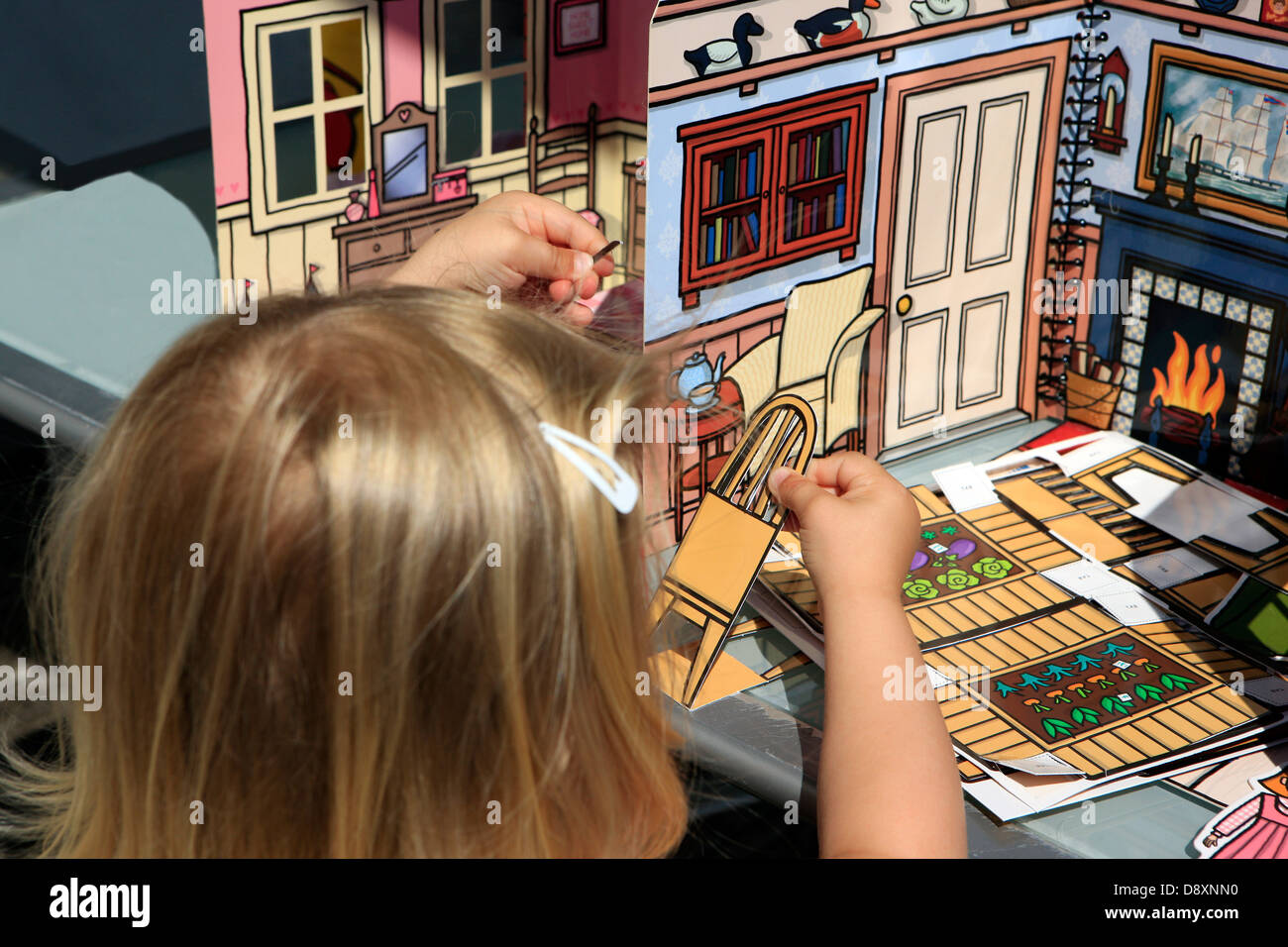 blond-haired-girl-playing-with-a-dolls-h