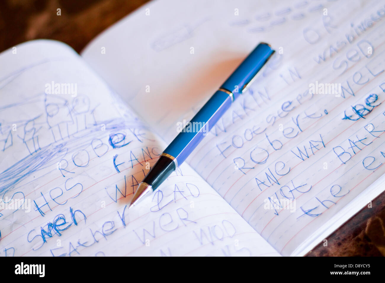 A child's handwriting in a journal learning to write Stock Photo