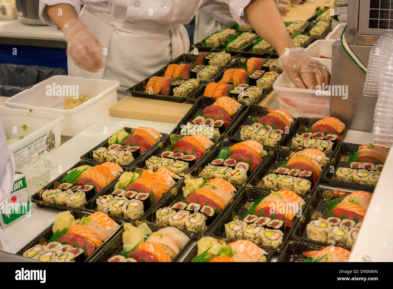 Chefs prepare sushi in the chelsea market in new york for Fish market restaurant nyc