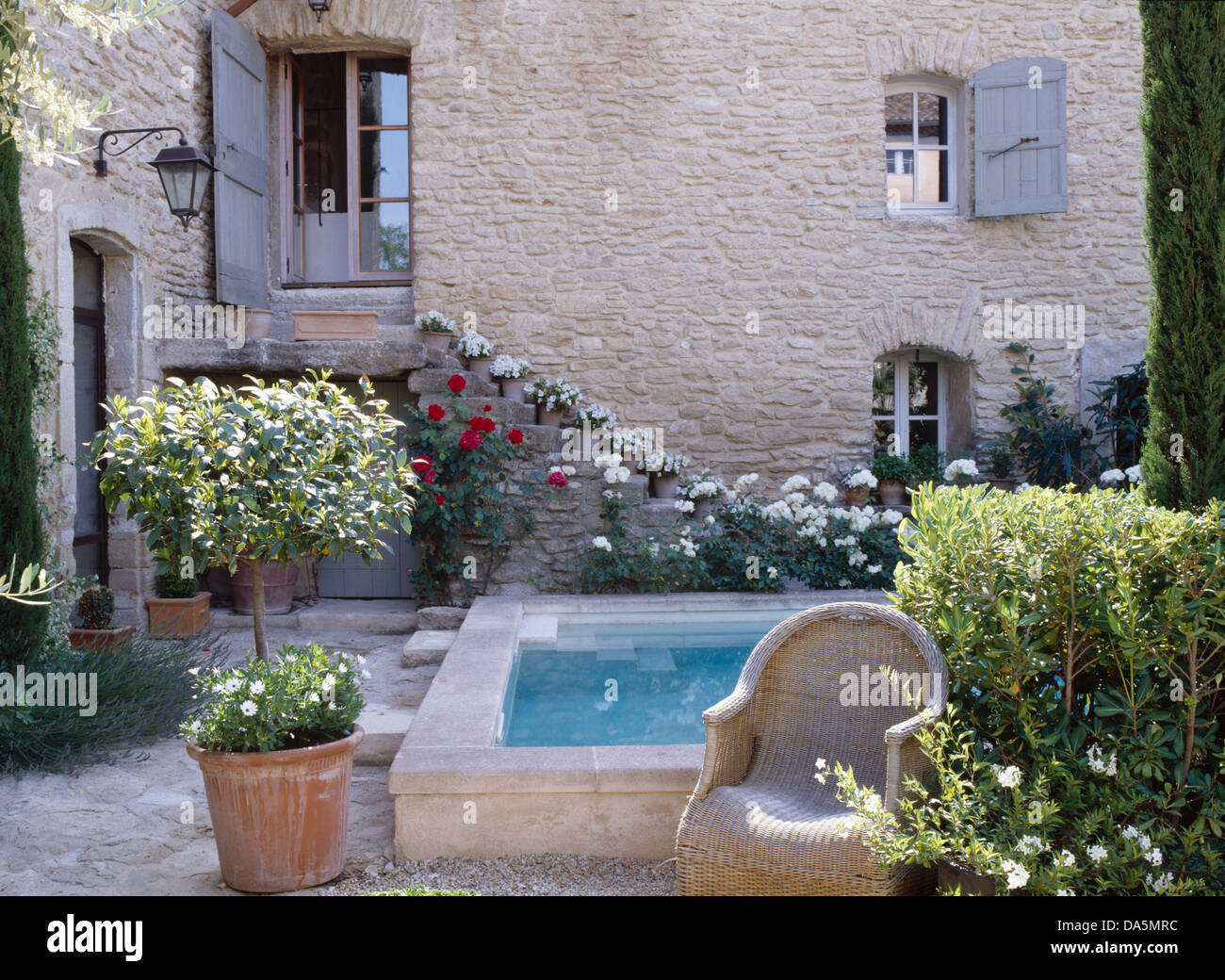 Small swimming pool in courtyard of french country house for Small french courtyard gardens