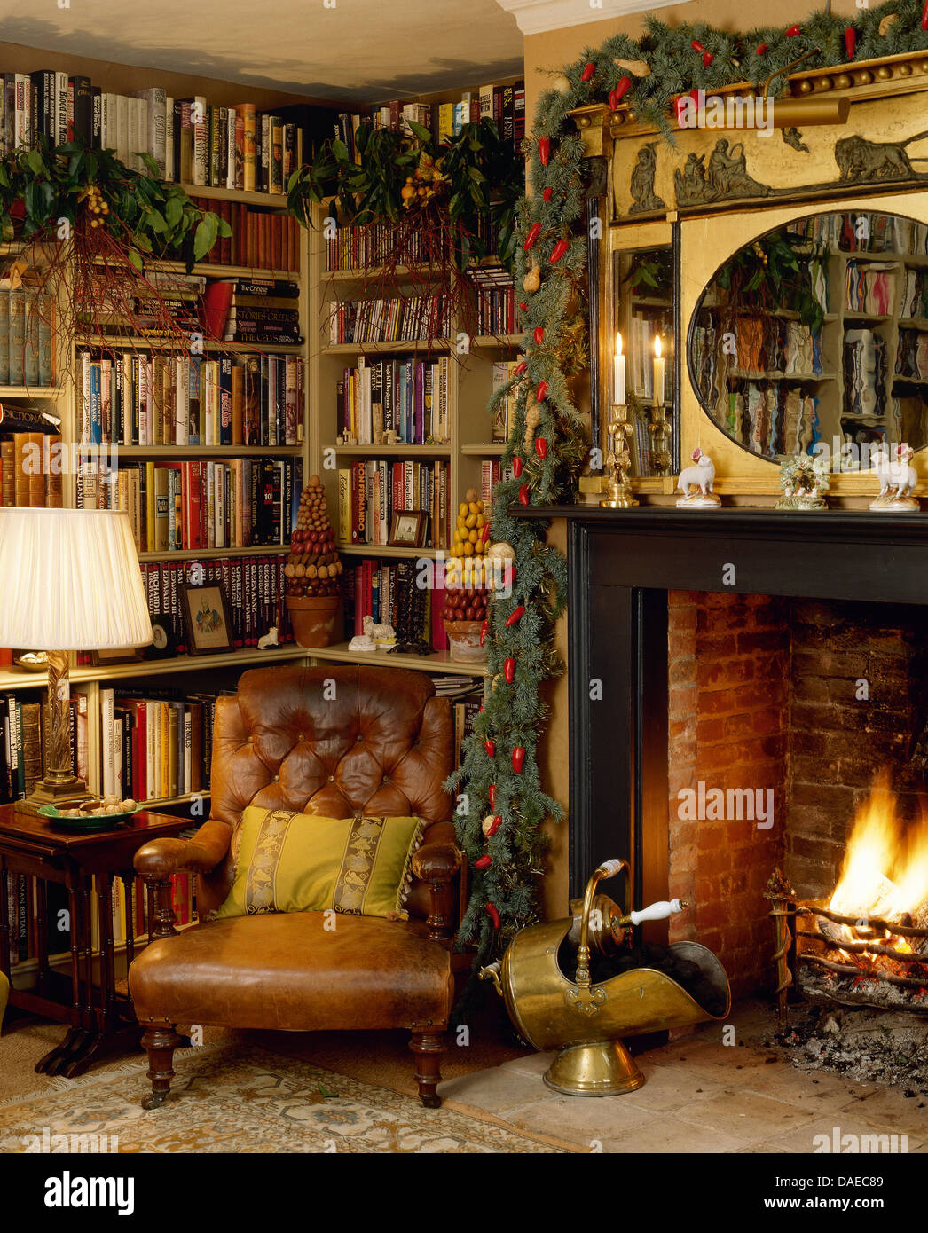 Bookshelves Beside Fireplace ~ Leather armchair in front of bookshelves and beside