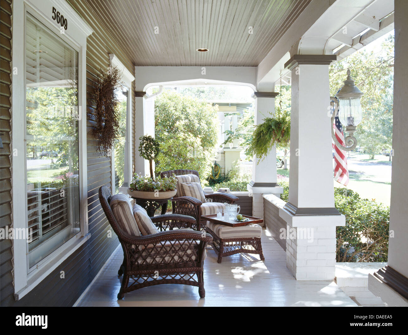 wicker armchairs on veranda of american colonial style house stock photo royalty free image. Black Bedroom Furniture Sets. Home Design Ideas