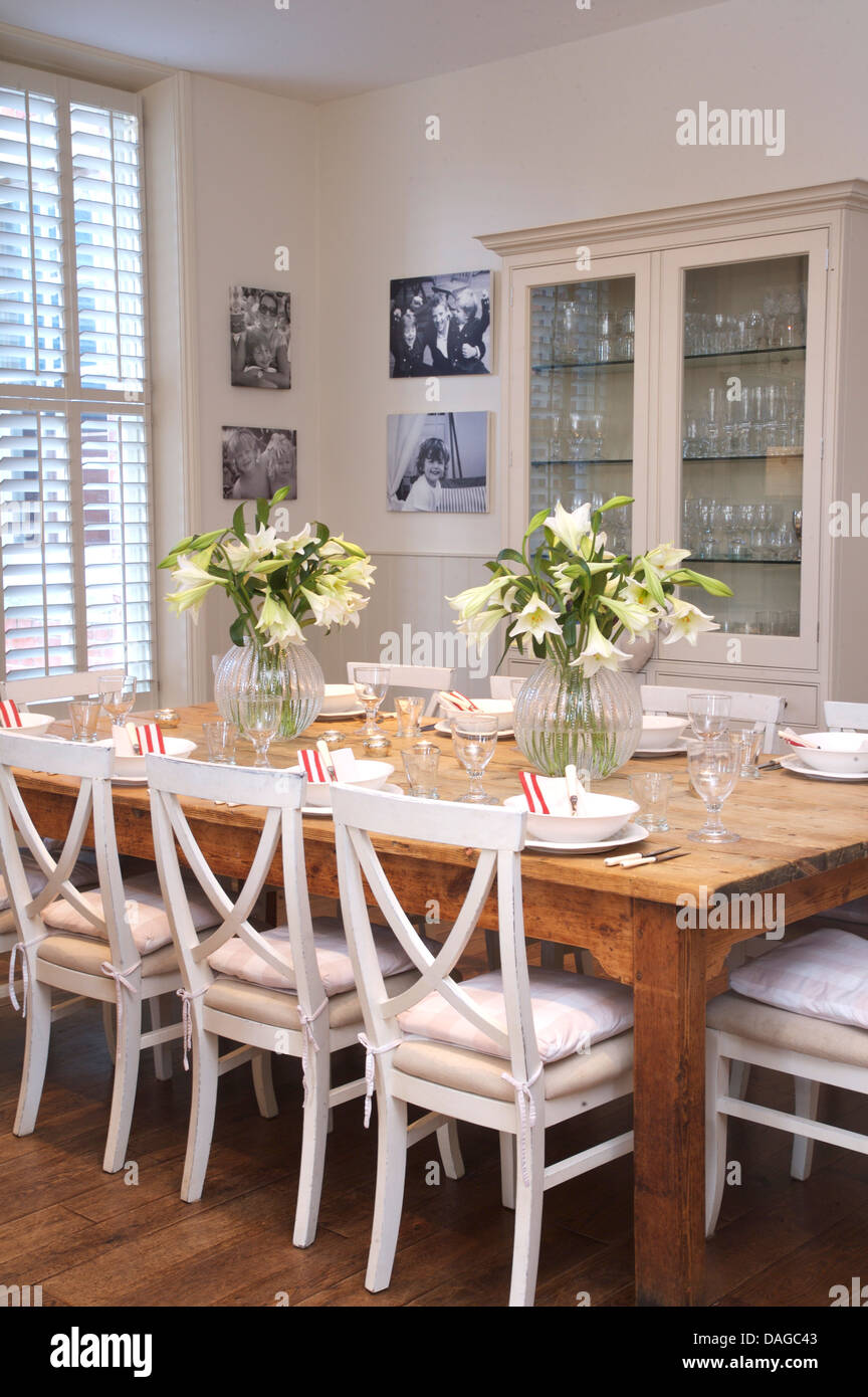 White Painted Chairs At Plain Wood Table In Country Dining