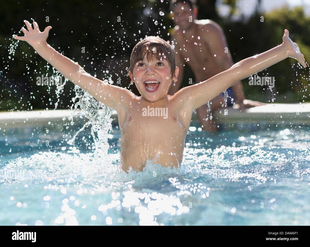 boy-playing-in-swimming-pool-DAM6F1.jpg