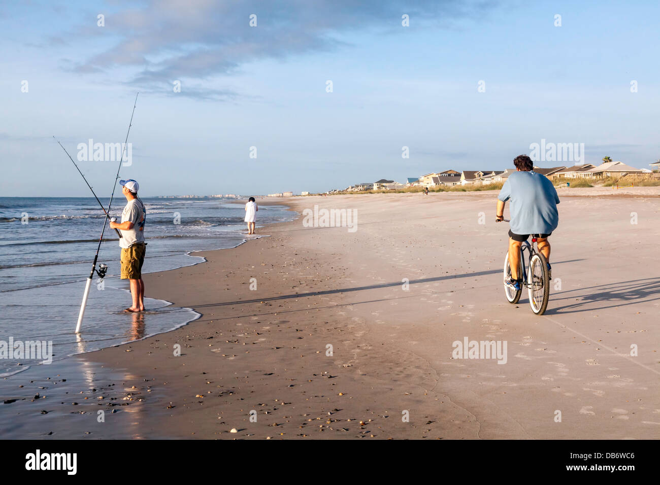 man-riding-bicycle-while-sea-angler-with