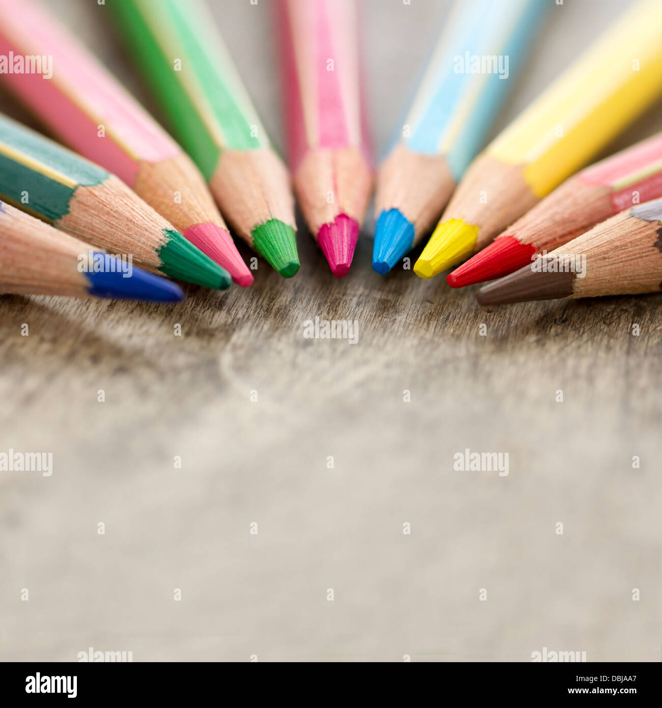Macro closeup of colorful wooden color pencils on rustic background and selective focus and copy space - back to Stock Foto
