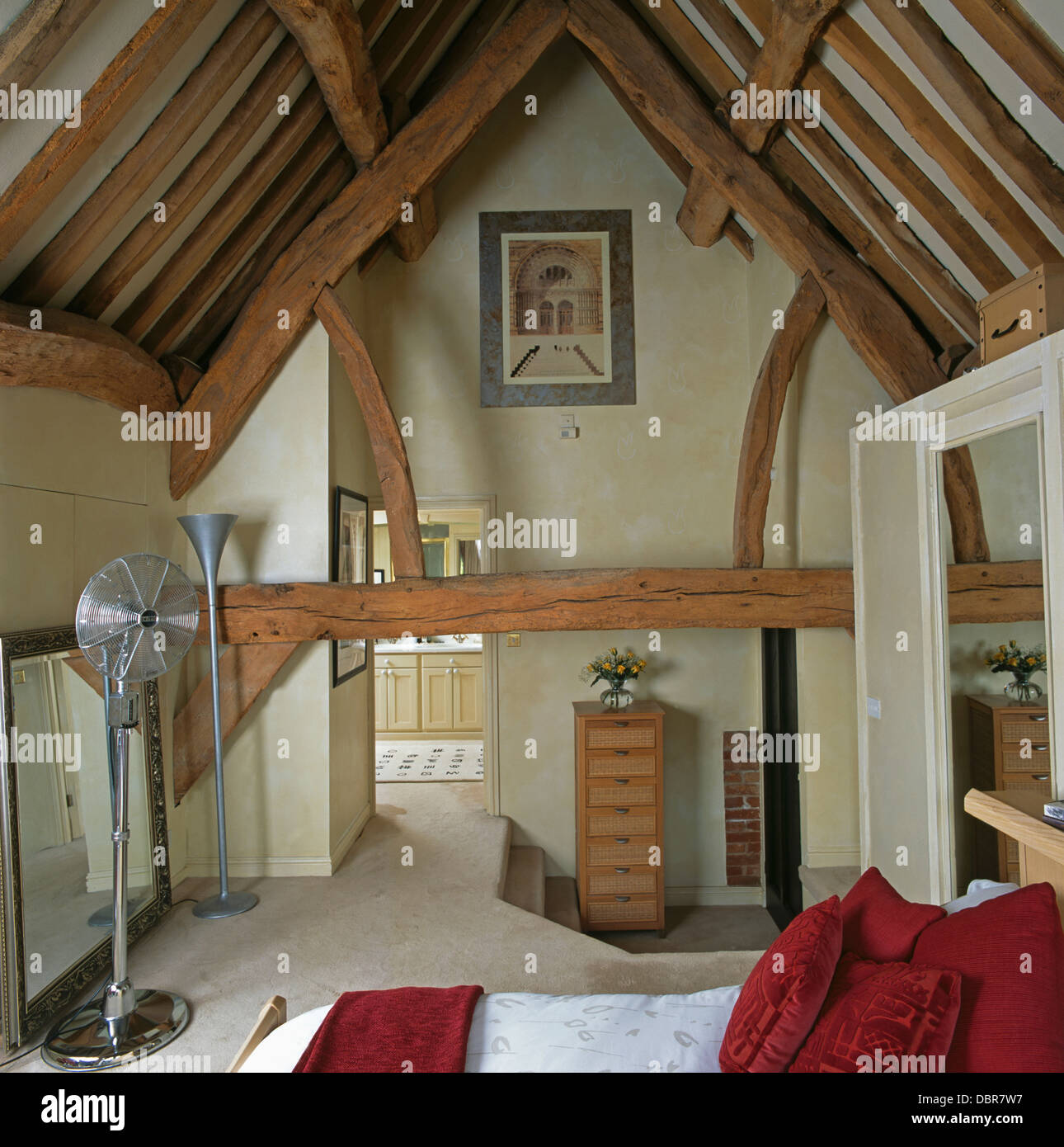 Rustic wooden beams on apex ceiling in barn conversion for Barn conversion bathroom ideas