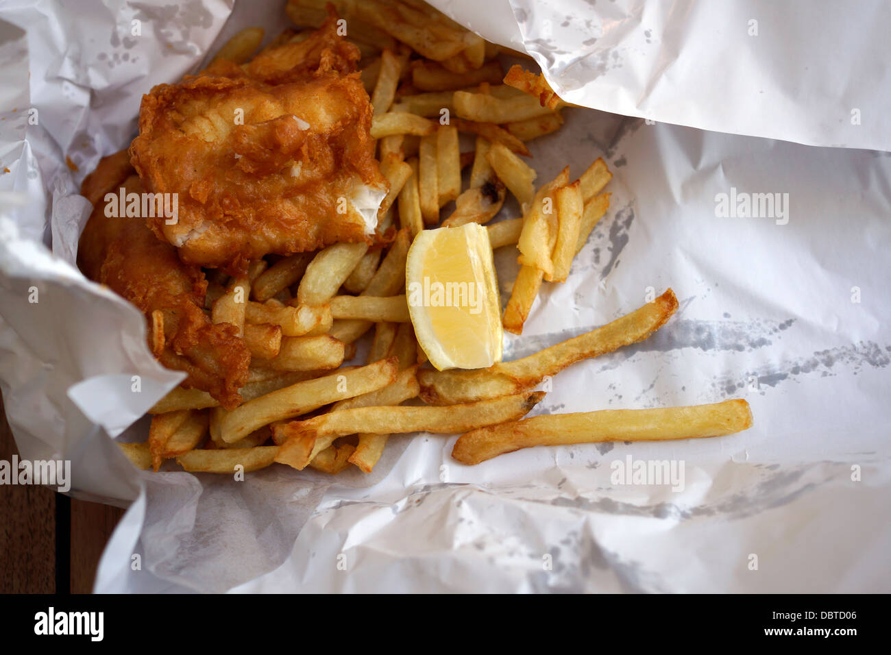Fish chips in paper wrapping from restaurant at kalk bay for Fish chips near me