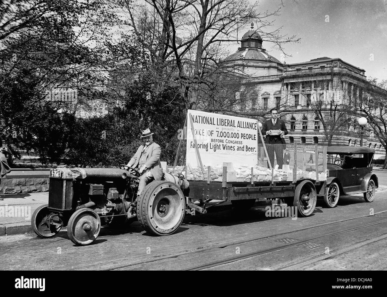 Tractor Pulling Trailer : Tractor pulling trailer with sign national liberal