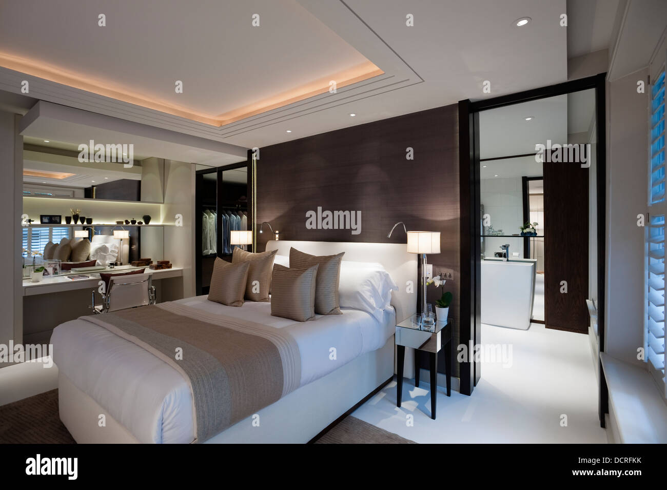 Bedroom of london city apartment with en suite bathroom and dressing stock photo royalty free Master bedroom ensuite and dressing room