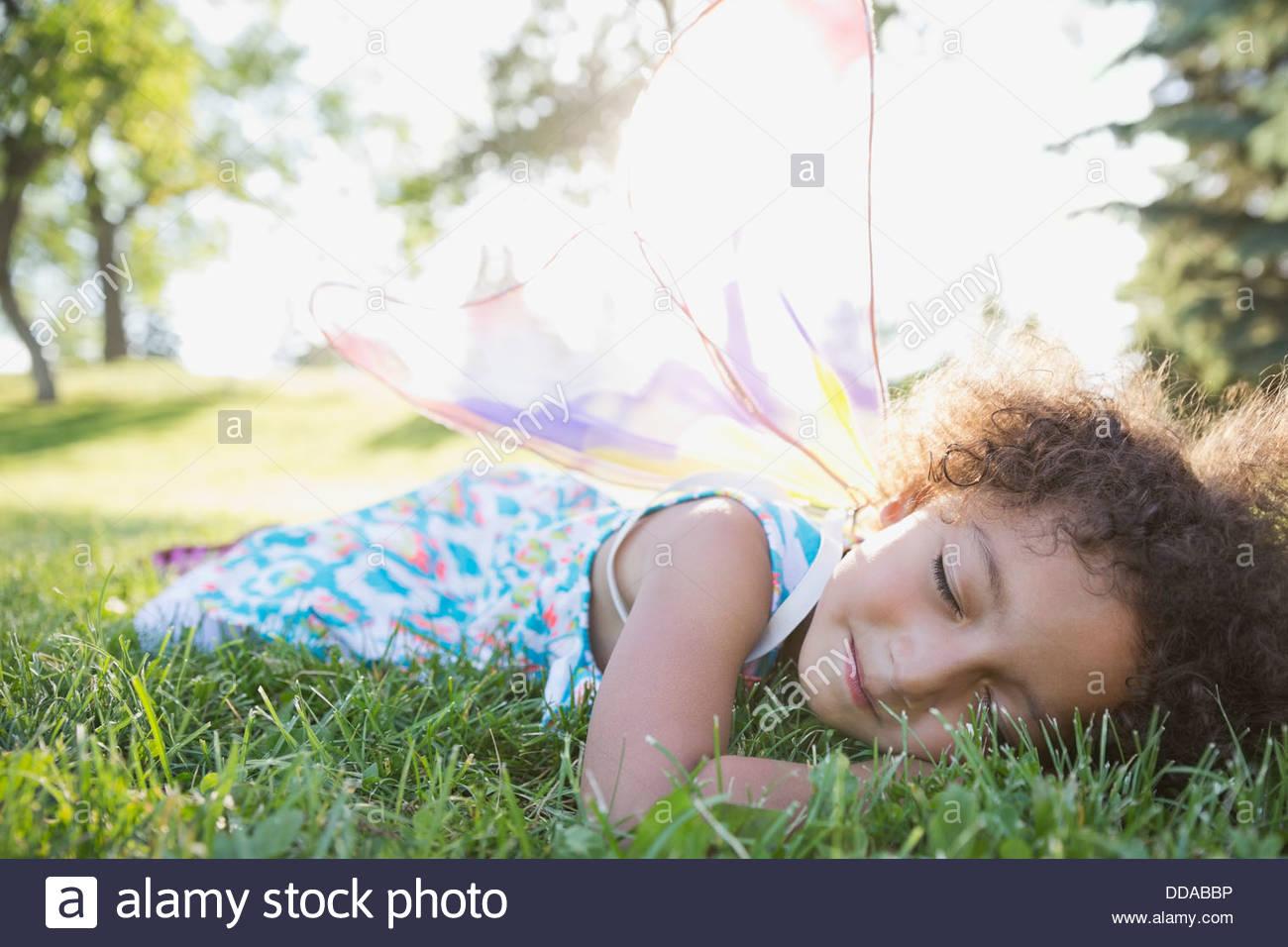 Cute Little Girl Sleeping On Grass Stock Photo Royalty