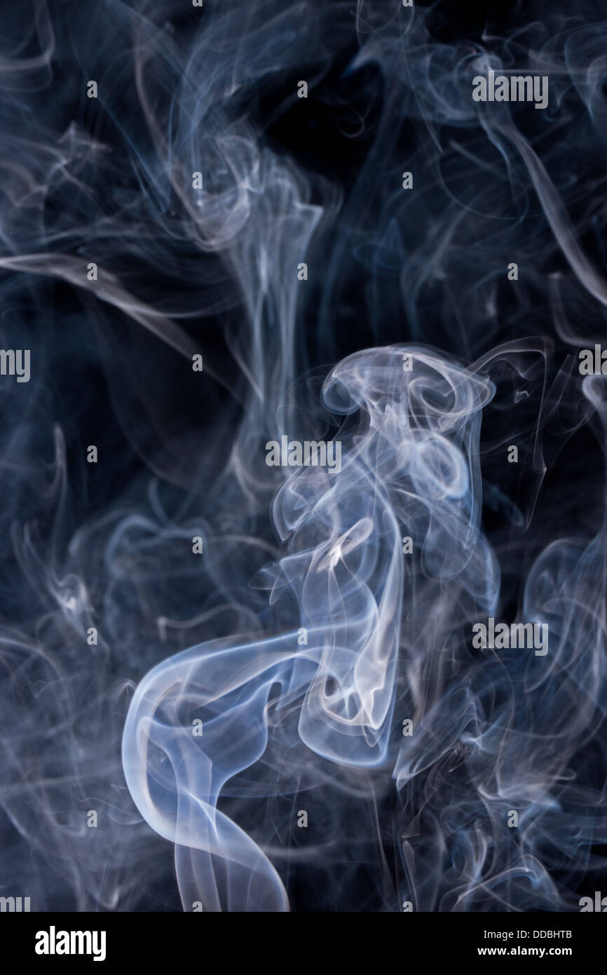 Smoke or Steam Rising against a Black Background Stock Photo