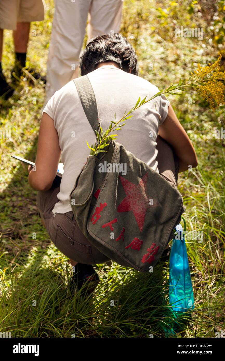 young-woman-with-a-khaki-messenger-bag-c