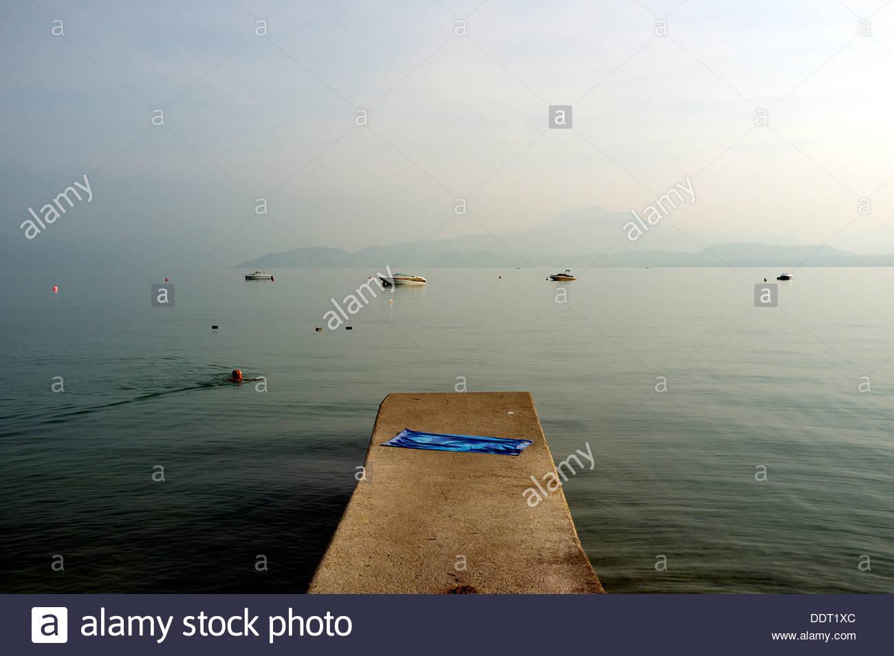 man-having-an-early-morning-swim-in-lake