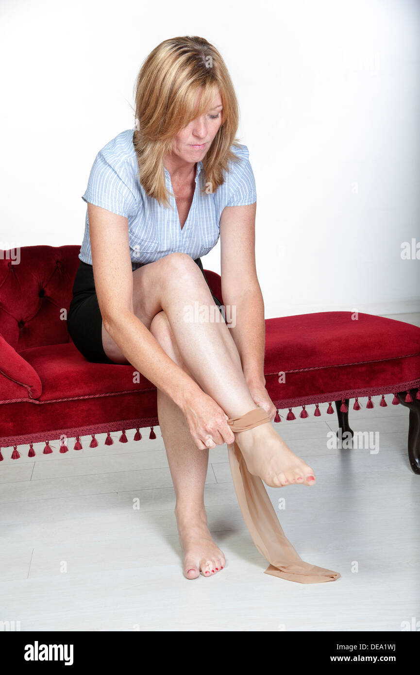 Woman Putting On A Pair Of Tights Stock Photo: 60457310
