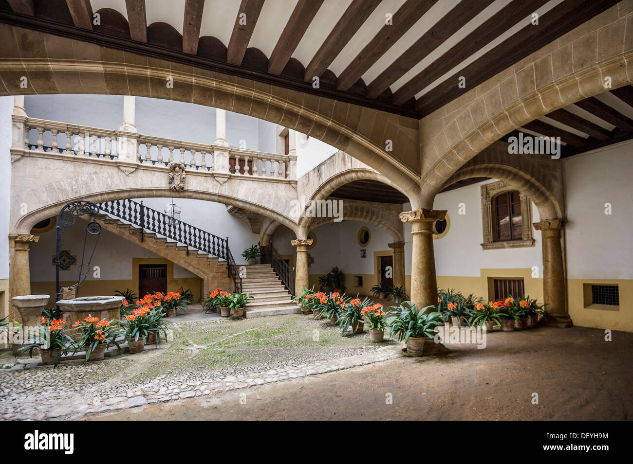 Courtyard of an old house with flower pots in the old Old world house plans courtyard