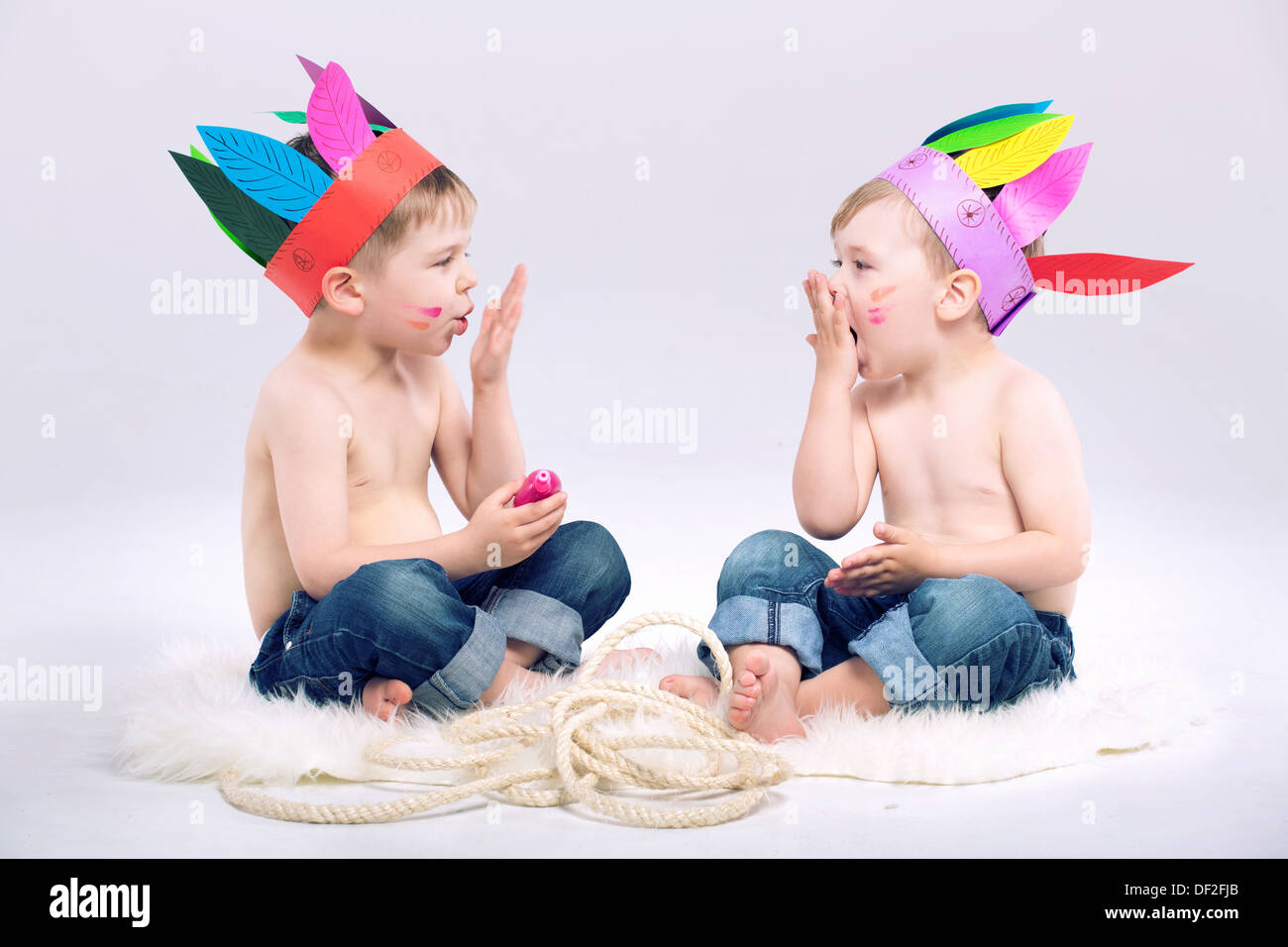 Young Indian boys with fancy colorful hats Stock Photo