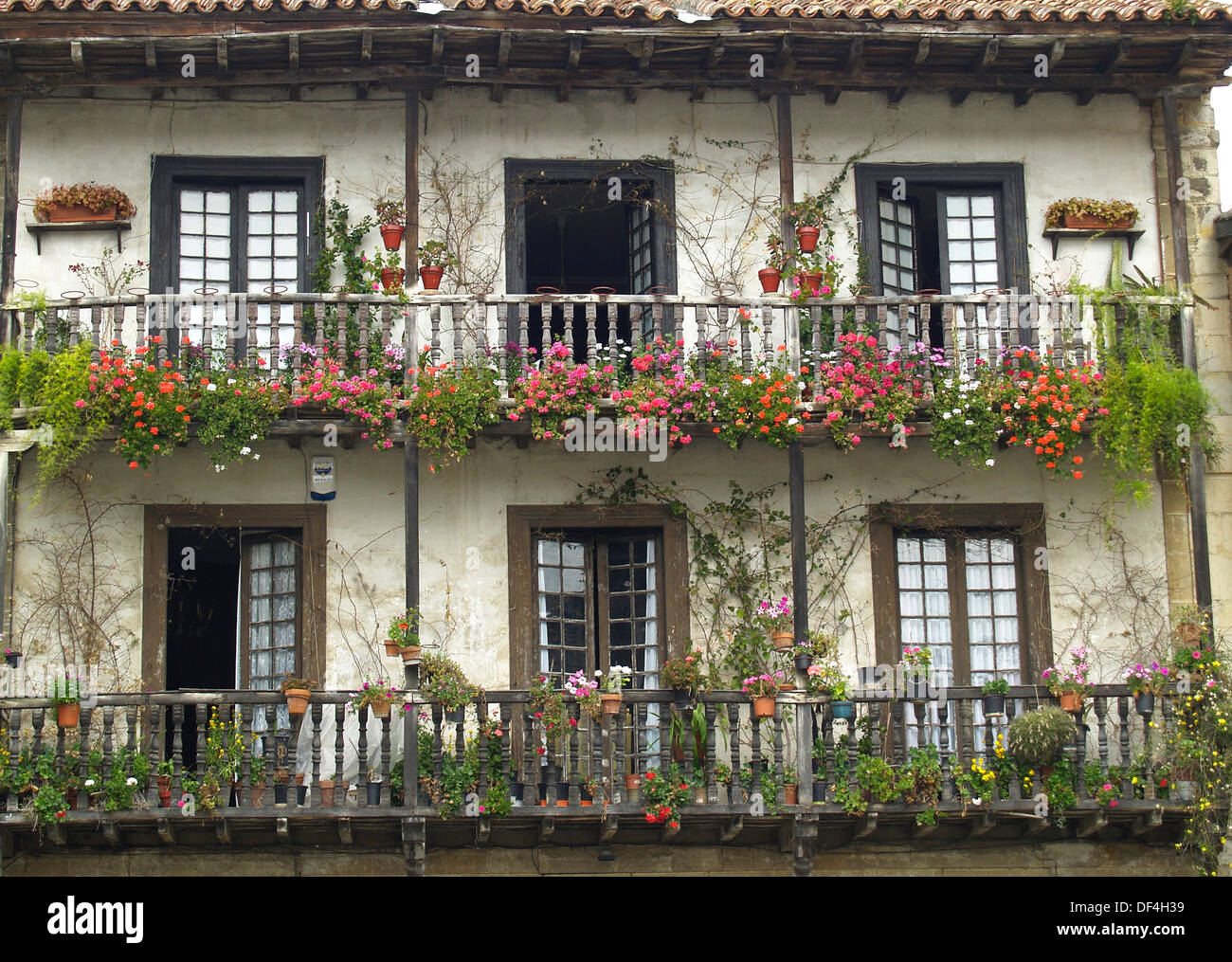 A flowered balcony in a spanish style house in santillana for Spanish style modular homes