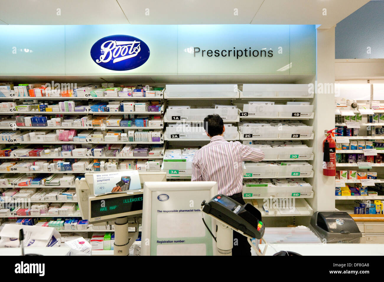 Boots the Chemist, the pharmacist working in the pharmacy, UK Stock Photo