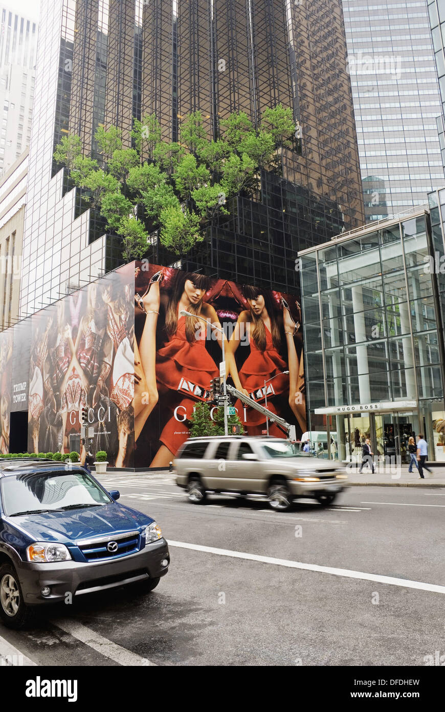 5th Avenue, Trump Tower with Gucci Advertising and Hugo Boss Store Front, Manhattan, New York City, New York, USA Stock Photo