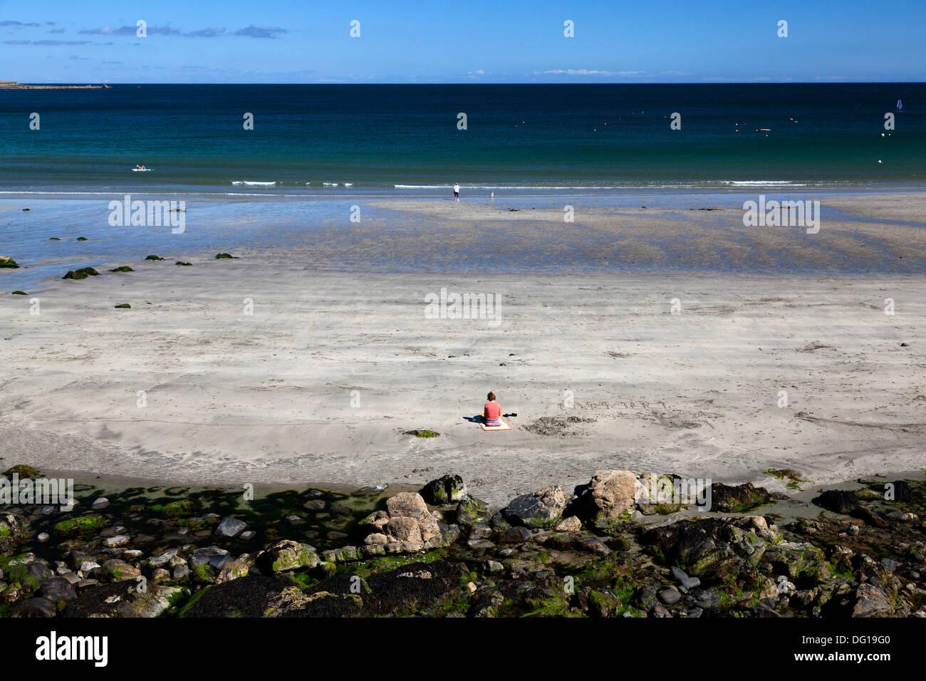 solitary-woman-sitting-on-the-beach-coverack-cornwall-DG19G0.jpg
