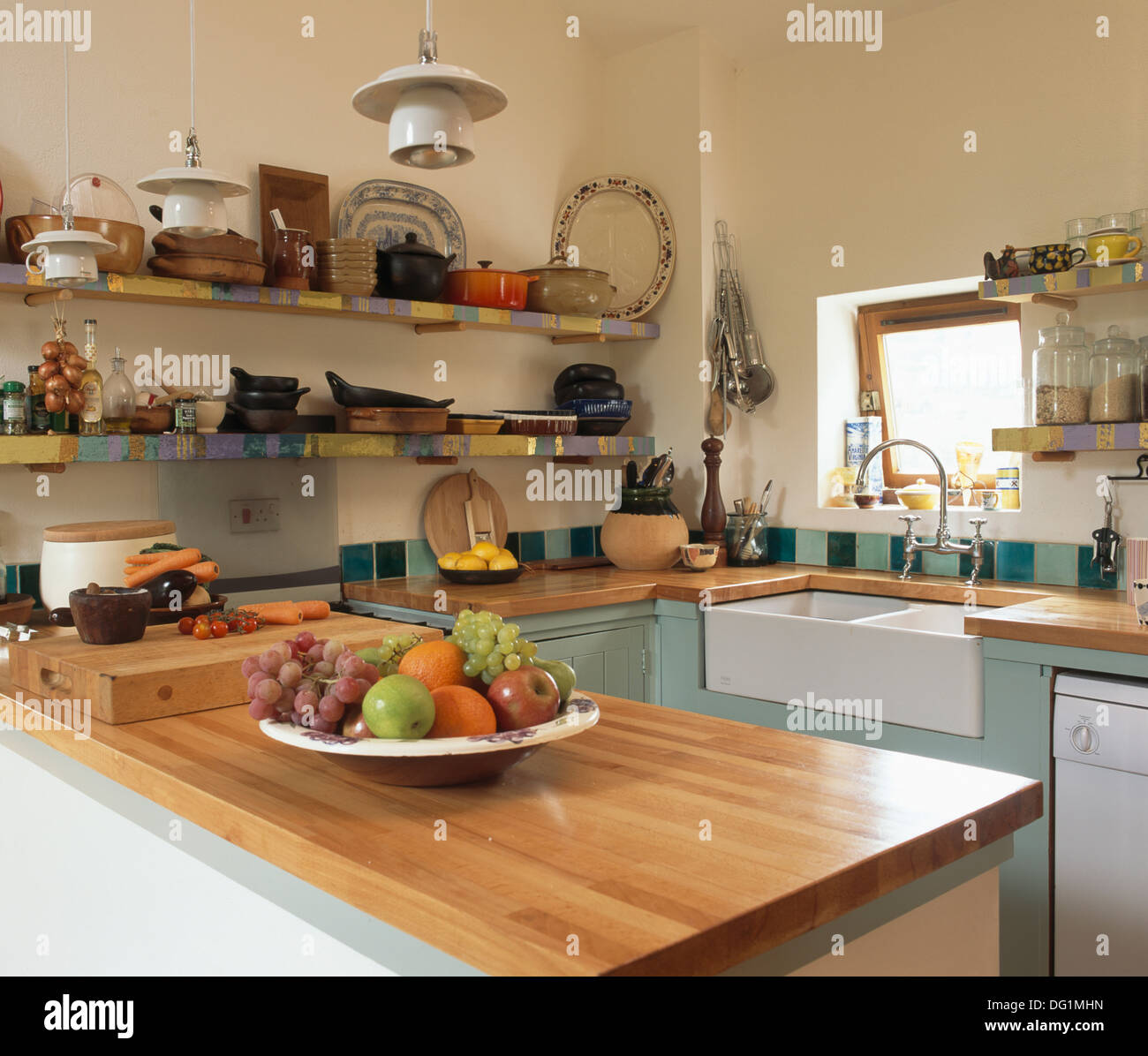 Cherry Wood Worktop In Small Country Kitchen With Belfast
