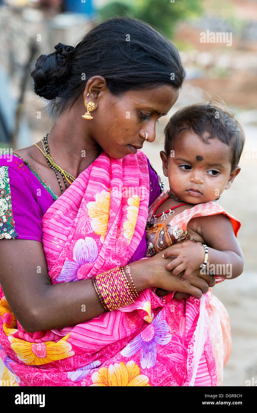 Young Lower Caste Indian Teenage Girl Holding Her Baby
