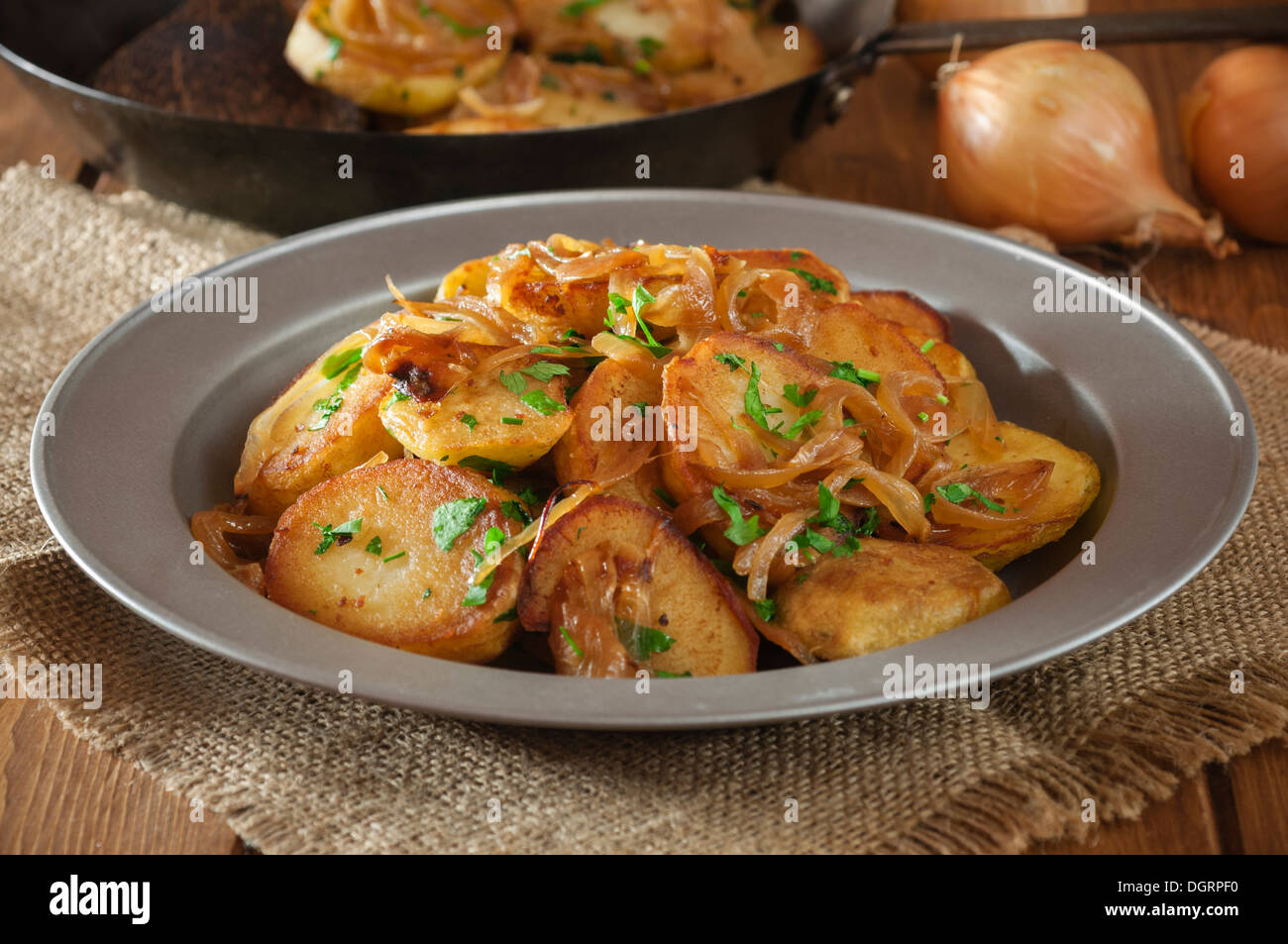 Lyonnaise potatoes. Pommes Lyonnaise. Fried potatoes with ...
