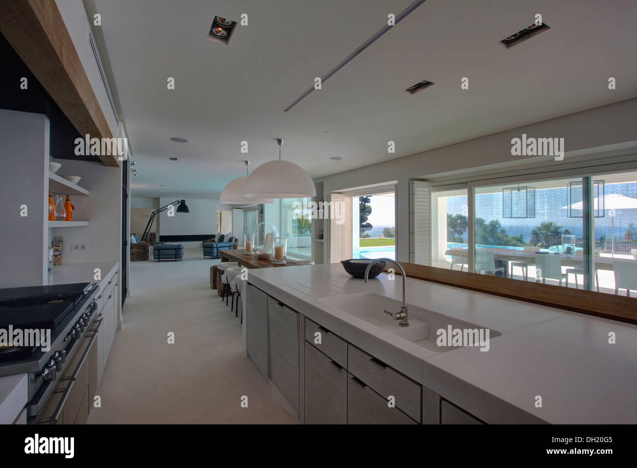 Sink and chrome tap in fitted unit below window in large for Large galley kitchen design ideas