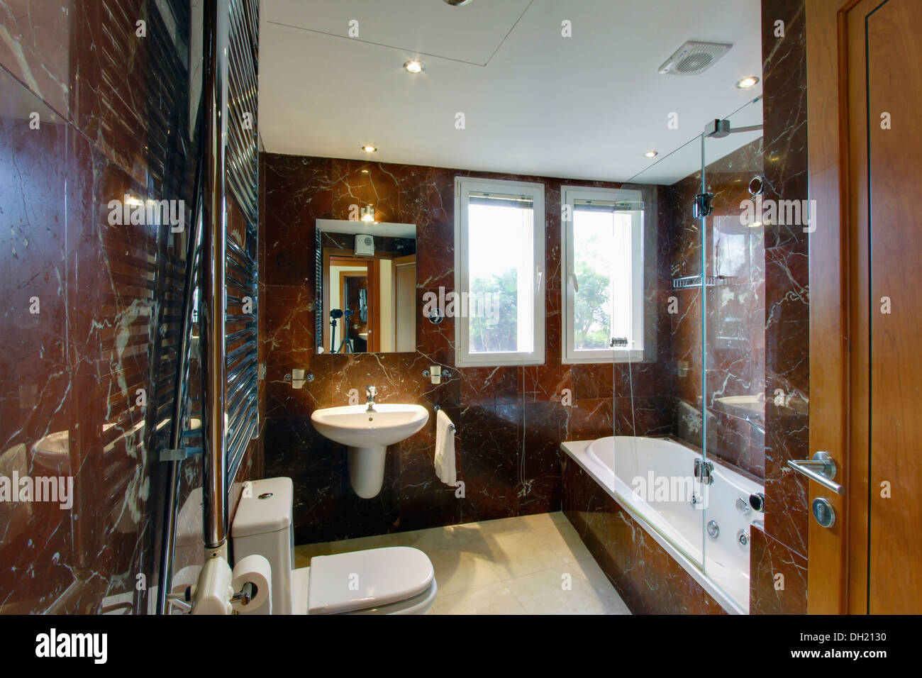 Modern Brown Marble Spanish Bathroom With Lighted Mirror