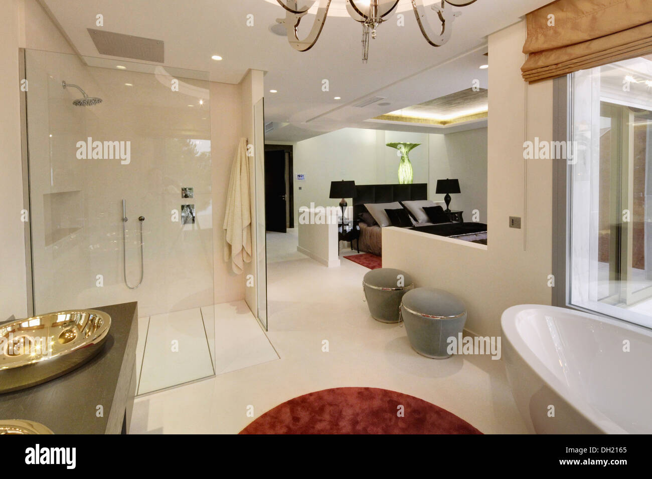 Large Walk In Shower And Gray Stools In Open Plan En Suite Bathroom Stock Photo 62125117 Alamy